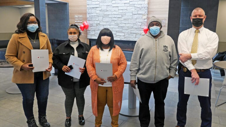 Syracuse Rescue Mission staff awarded National Lifesaving Awards by the American Red Cross (from left to right): Dovenin Agbossoumonde, Rosalia Hernandez, Kyara Jones, James Jordan, Deputy Stephen Smolen (Onondaga County Sheriff's Department). Not pictured: Keith Rodgers and Melissa Swift